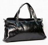 Женская сумка Palio выполнена из кожи черного цвета.